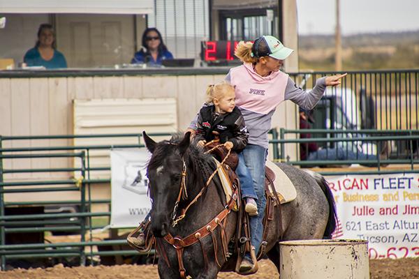barrel racing cowgirls
